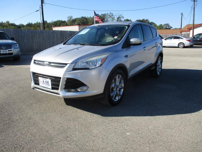 2013 Ford Escape SEL FWD (1FMCU0H94DU) with an 2.0L L4 DOHC 16V engine, 6-Speed Automatic transmission, located at 23980 F.M 1314, Porter, TX, 77365, (281) 354-3355, 30.104134, -95.249527 - Photo #0